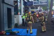 Fire personnel attend an emergency call-out at Swanson Towers. Photo / Nick Reed