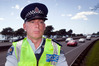 Constable Ian Sadler monitoring the Labour Weekend traffic on the Takitumu Drive overbridge. Photo/Andrew Warner.