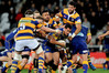 TIGHT GAME: Bay of Plenty players swarm around an Otago player in the semifinal played in Dunedin. PHOTO/photosport