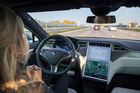 Every new Tesla rolling off the factory floor will now come with the hardware necessary to support full autonomous driving mode. Photo / Bloomberg