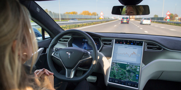 Loading Every new Tesla rolling off the factory floor will now come with the hardware necessary to support full autonomous driving mode. Photo / Bloomberg
