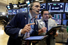 Traders Gregory Rowe, left, and Joseph Lawler work on the floor of the New York Stock Exchange. Photo / AP