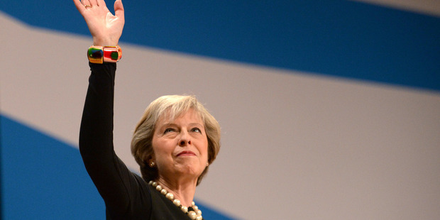 Prime Minister Theresa May has said she will trigger the formal divorce procedure from the EU. Photo / AP
