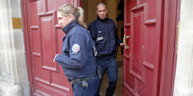 French police officers exit the residence of Kim Kardashian West in Paris. Photo / AP