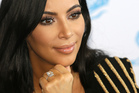 A Paris judicial police source says the gang of robbers stayed put in and around Kim Kardashian's apartment for up to 49 minutes. Photo / AP