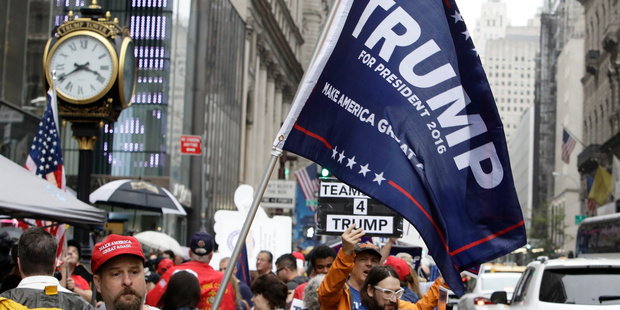 Supporters of Republican presidential nominee Donald Trump gather at Trump Tower. Photo / AP