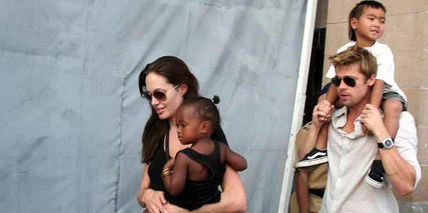 American actress a Angelina Jolie with her daughter Zahara and Brad Pitt with Jolie's son Maddox. Photo / AP