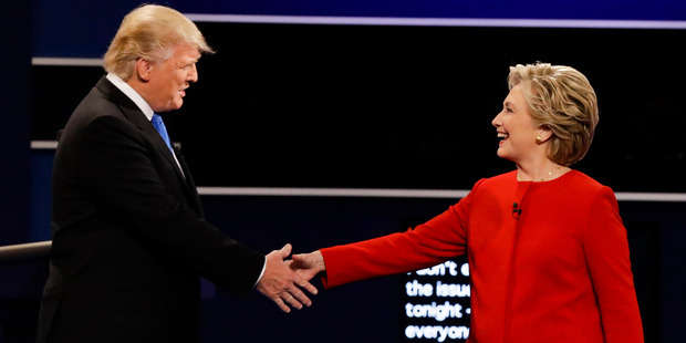 Republican presidential nominee Donald Trump and Democratic presidential nominee Hillary Clinton shake hands during the presidential debate at Hofstra University. Photo / AP