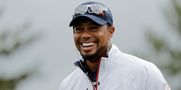 United States vice-captain Tiger Woods smiles during a practice round for the Ryder Cup. Photo / AP