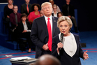 Democratic presidential nominee Hillary Clinton speaks as Republican presidential nominee Donald Trump listens during the second presidential debate. Photo / AP