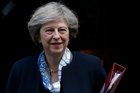 Theresa May's determination to curb immigration could cost Britain its tariff-free access to the EU single market of 450 million people, damaging the economy. Photo / AP