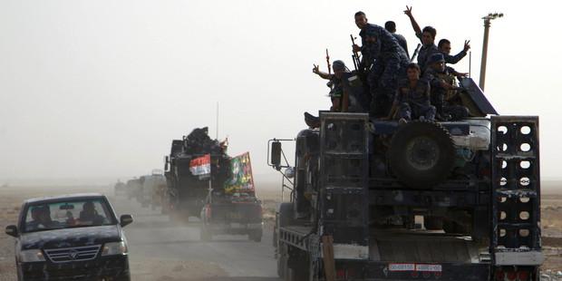 Iraqi soldiers in convoy of Iraqi military vehicles heads toward Qayyarah base in northern Iraq. Photo / AP