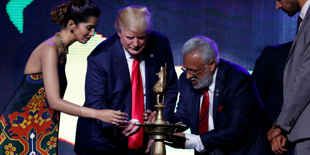 Donald Trump lights a diya before delivering remarks to the Republican Hindu Coalition. Photo / AP