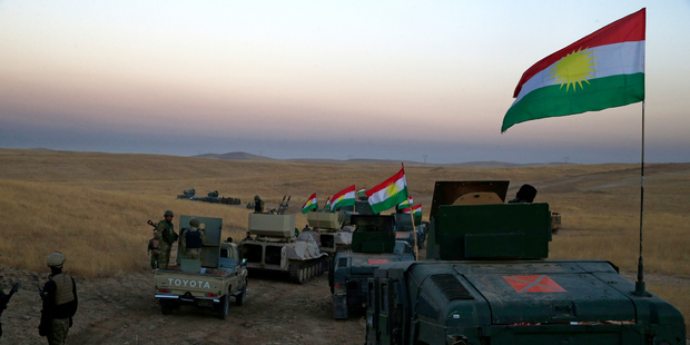 A Peshmerga convoy drives towards a frontline in Khazer, about 30 kilometers (19 miles) east of Mosul, Iraq. Photo / AP