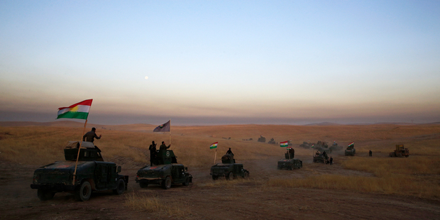A Peshmerga convoy drives towards a frontline in Khazer, about 30 kilometers east of Mosul, Iraq. Photo / AP