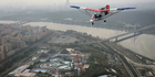 An ultralight aircraft flies over Pyongyang. Photo / AP