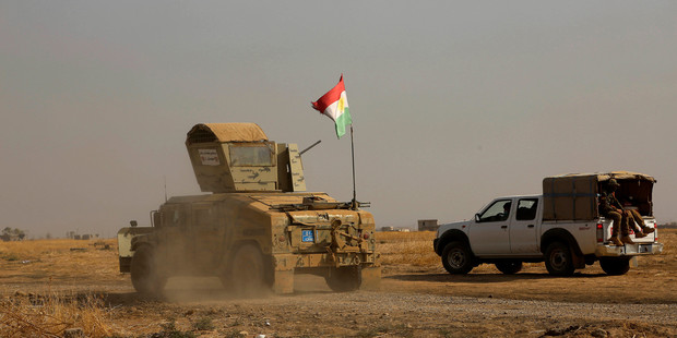 Iraqi government and Kurdish forces, backed by U.S.-led coalition air and ground support, launched coordinated military operations early on Monday. Photo / AP