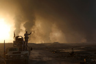 Smoke rises from Isis positions after an airstrike by coalition forces in Mosul. Picture / AP