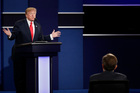 Republican presidential nominee Donald Trump answers a question during the third presidential debate. Photo / AP