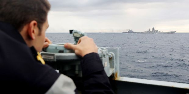 Britain's Ministry of Defence photo and taken on Tuesday (UK time), showing a Royal Navy lookout onboard HMS Richmond, observing Russian aircraft carrier Admiral Kuznetsov. Photo / AP