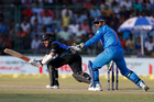 Kane Williamson sweeps during their second one-day international against India. Photo / AP