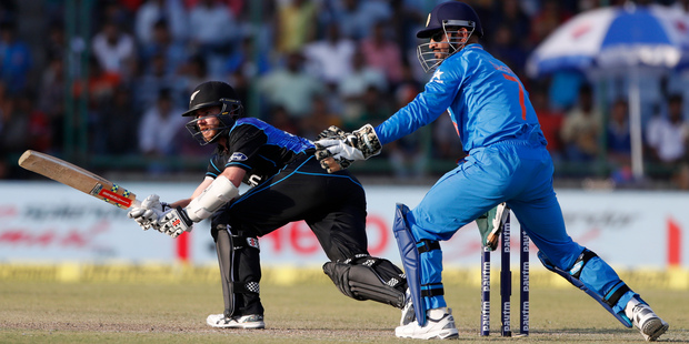 Loading Kane Williamson sweeps during their second one-day international against India. Photo / AP