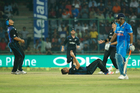 New Zealand's Tim Southee, center lying on the ground, celebrates the wicket of India's captain Mahendra Singh Dhoni during their second one-day international cricket match in New Delhi. Photo / AP