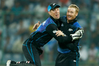 New Zealand's Luke Ronchi and Martin Guptill celebrate during this morning's thrilling six-run win over India. Photo / AP.