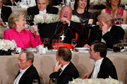 Republican presidential candidate Donald Trump, right, Cardinal Timothy Dolan, Archbishop of New York, center, and Democratic presidential candidate Hillary Clinton share a laugh during the Alfred E.