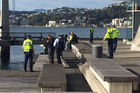 Emergency services at the scene after Finbarr Clabby's body was discovered in Wellington Harbour. Photo / NZME