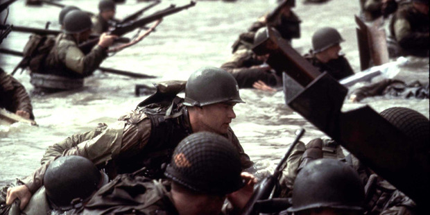 Actor Tom Hanks leads his men towards the beach during scene from Saving Private Ryan.