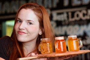 Bartender Joanna Claire offers some tasters at Mount Brewing Co, which has been named as a finalist in this year's regional hospitality awards. Photo/file