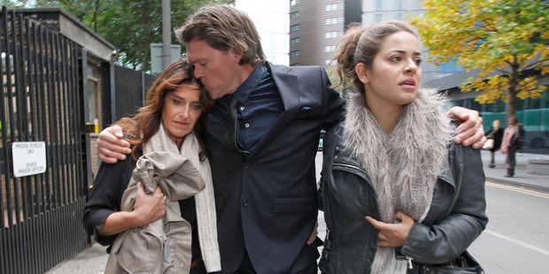 Lou Vincent leaves Southwark Crown Court in London, with his partner Susie Markham and her daughter Tina, after giving evidence. Photo / Chris Gorman.