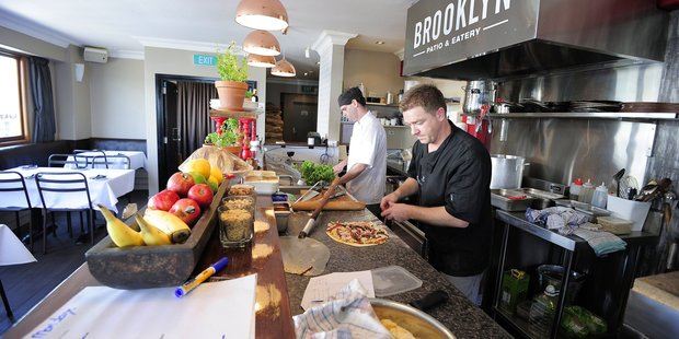 Chefs prepare pizza at Brooklyn Patio & Eatery, which is up for an award at this year's regional hospitality awards. Photo/file
