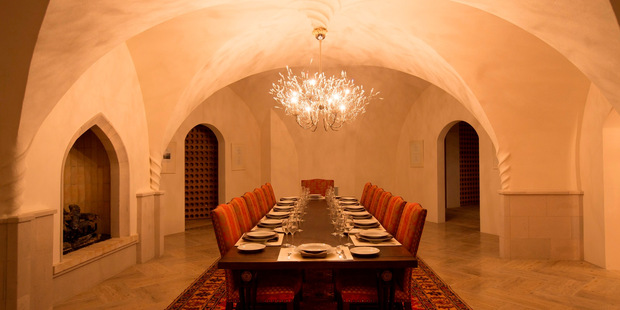 No expense was spared in the build - the dining room features chandeliers and floors from Italy. Photo / Barfoot and Thompson