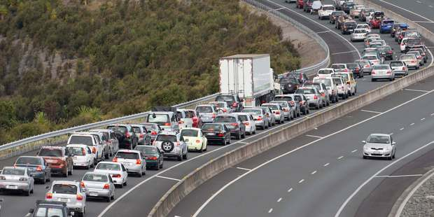 The roads will be clogged with holiday-makers this long weekend. Photo / Greg Bowker
