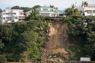This clifftop house (left) was demolished and the vacant Parnell section has just sold for $9.25m. Photo / Greg Bowker