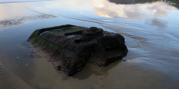 Some surfers say part of the boiler, the only other remnant of the wreck still above the sand, is now a danger. Photo / Francis Malley