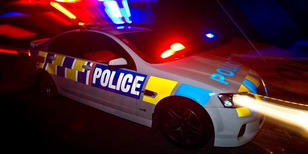 HBT132422-04  Police car at night.