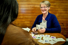 Money coach Joy Tomoana helps a client using a card game. Photo / Warren Buckland, Hawke's Bay Today