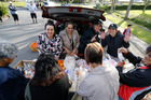 Selina Harris, Reriana Rewha-Gardener, Shirley-Anne Paul and Hadassah Mahanga put together lunch packs for families in need.