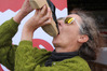 Julie Twist eats an oyster from her shoe in the 'Most Disgusting Way to Eat an Oyster' competition at last year's Oyster Feastival. Photo / Peter de Graaf