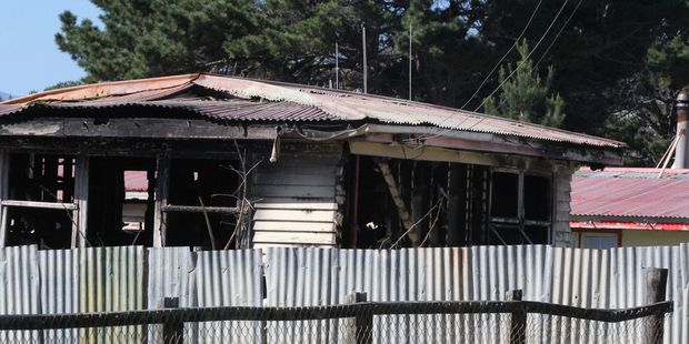 The burnt out house at Hokio Beach is linked to the disappearance of Levin man Palmiro MacDonald, whose remains have been found in the Tararura Foothills. Photo / File.