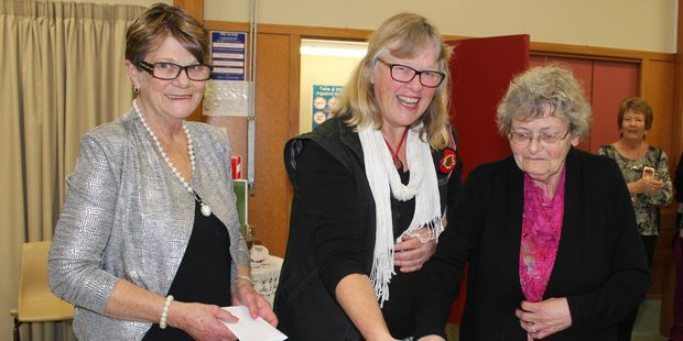 The 30th anniversary opening of the Dannevirke Cottage Quilters, president, Pam Smith, left, Sue Langridge and Jill Mills. Photo / Christine McKay