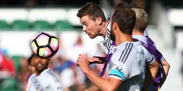 Loading Phoenix defender Jacob Tratt gets the heads-up on the Perth Glory last night. Photo / Getty Images