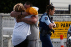 People console each other outside St John Ambulance Whangarei in Kensington, after a critically injured man died.