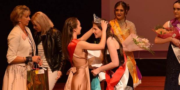 Miss Far North 2016, Megan Hammerton (Okaihau), receiving her crown from her predecessor, Danielle Collings.