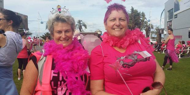 Breast cancer survivors Lynda Murdoch and Sharon McAuliffe get into the spirit at the Hot Pink Walk at The Strand. Photo/Allison Hess