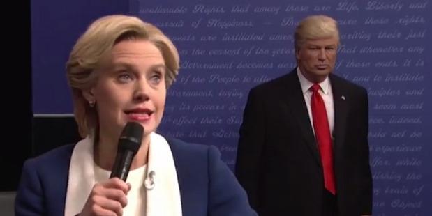 Loading Alec Baldwin as Donald Trump lurks behind Kate McKinnon as Hillary Clinton. Photo / NBC