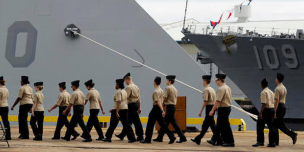 Members of the Navy Junior Reserve Officers Training Corps walk past the bow of the USS Zumwalt. Photo / AP